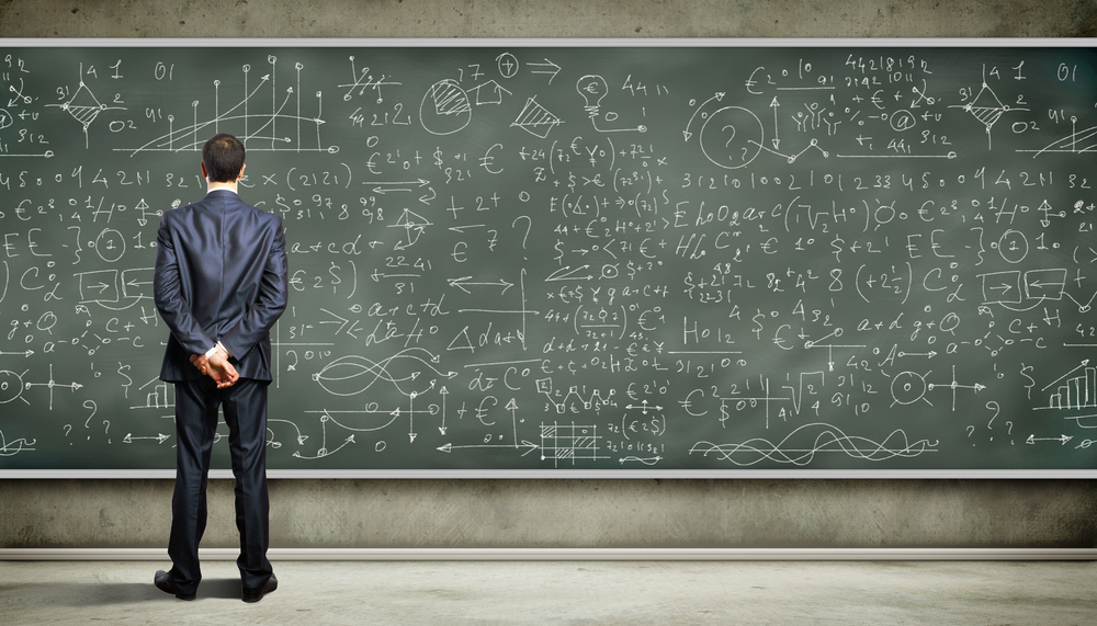 Business person standing against the blackboard with a lot of data written on it-1